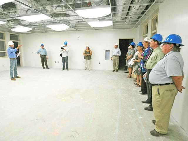 Dennis Kuykendall of Balfour Beatty Construction, left, discusses the progress of construction in a classroom with the Saugus Union School District Board at Emblem Elementary School in Saugus on Tuesday evening.