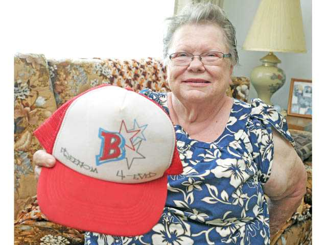 Joyce Larson, of Saugus, displays the hat she used to flag down a helicopter pilot when she and her husband were stranded with their car in the hills above Castaic. The pair was stranded from Saturday evening until Monday.