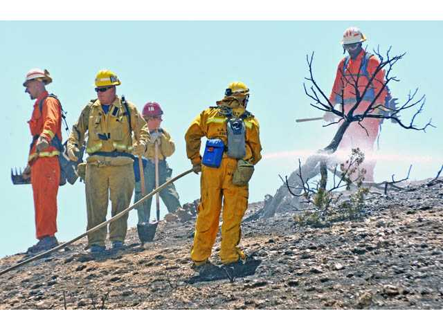 Firefighters contain Highway 14 fire