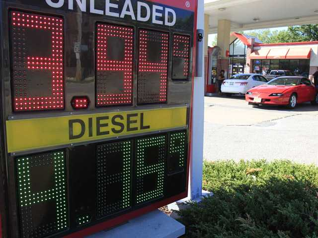A man fills his gas tank at a gas station Wednesday in South Euclid, Ohio. Drivers are facing the biggest one-day jump in gasoline prices in 18 months as Hurricane Isaac swamps the nation's oil and gas hub along the Gulf Coast.