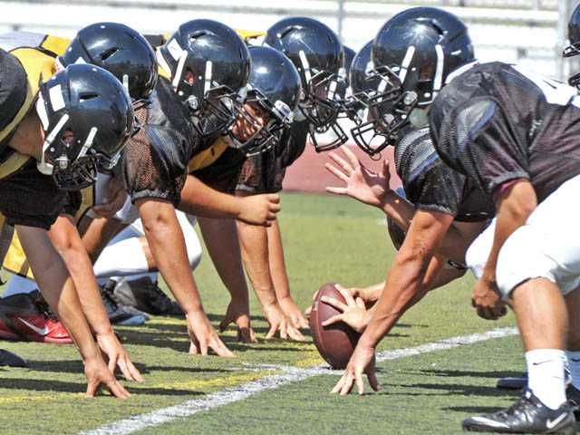 Hart High players line up for team drills during a practice on Aug. 13 at Hart High School. This week, Hart travels to face Tesoro.