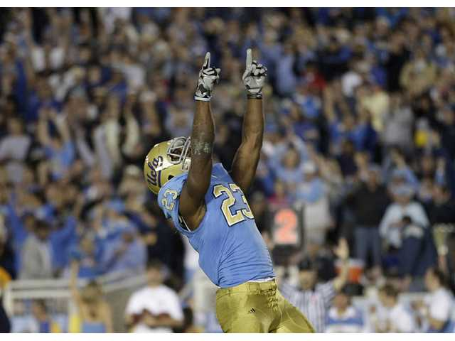UCLA running back Johnathan Franklin celebrates after scoring a touchdown against Oregon State at the Rose Bowl in Pasadena on Nov. 6, 2010.