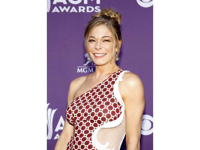This April 1, 2012 file photo shows country singer and actess LeAnn Rimes arriving at the 47th Annual Academy of Country Music Awards in Las Vegas.