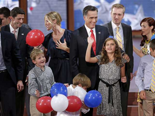 Republican presidential nominee Mitt Romney, vice presidential nominee, Rep. Paul Ryan and their families watch the balloons drop during the Republican National Convention in Tampa, Fla., on Thursday.