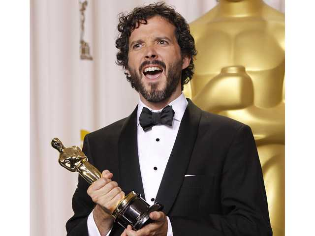 "In this Feb. 26 photo, Bret McKenzie poses with his award for best original song for ""Man or Muppet"" during the 84th Academy Awards in the Hollywood section of Los Angeles."