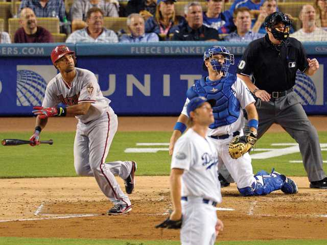 Arizona Diamondback Chris Young, left, watches his two-run home run as Los Angeles Dodgers starting pitcher Clayton Kershaw looks on Thursday in Los Angeles.