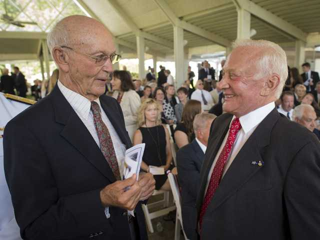 "Apollo 11 astronauts Michael Collins, left, and Edwin ""Buzz"" Aldrin, talk at a private memorial service celebrating the life of Neil Armstrong on Friday at the Camargo Club in Cincinnati."