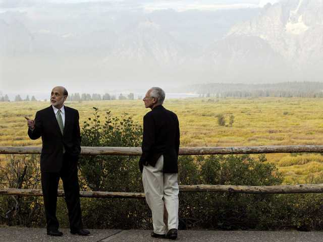 Federal Reserve Chairman Ben Bernanke, left, and Stanley Fischer, right, Governor of the Bank of Israel, talk together on Friday at Grand Teton National Park near Jackson Hole, Wyo.