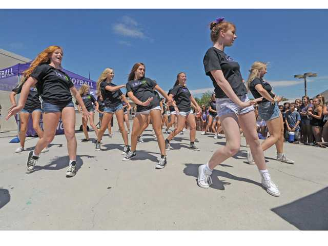 The Valencia High School dance team, wearing DFYiT T-shirts perform for Valencia High students at the DFYiT anti-drug kickoff event held at Valencia High School on Friday.