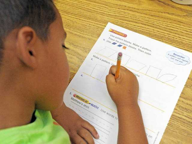 First-grader Brandon Garcia, 6, works on an exercise in patterns.