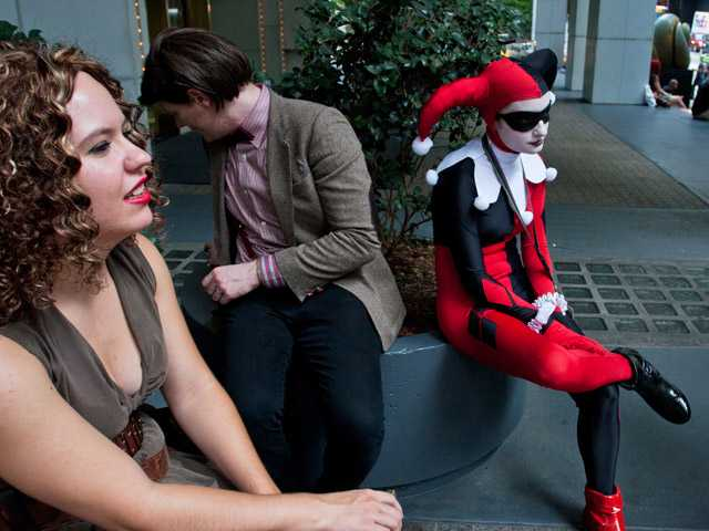 Attendees sit outside a hotel at Dragon Con in Atlanta, on Friday.