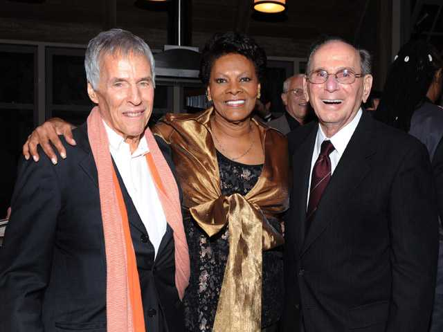 This Oct. 17, 2011, photo shows legendary songwriters Bert Bacharach, left, and Hal David pose with singer Dionne Warwick in Los Angeles.