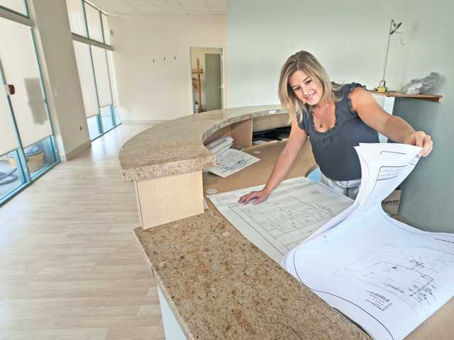 Ronchetto studies plans for her clinic in the lobby of the new Cinema Veterinary Centre in Valencia on Wednesday.