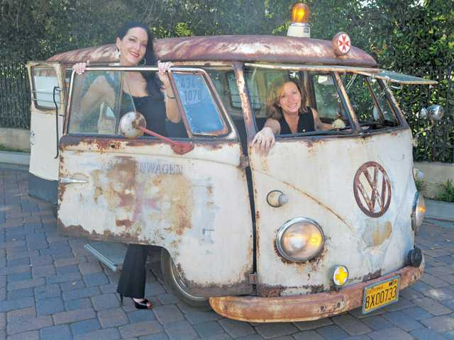 Shelley Hann and Jo Ann Vindigni in a rare unrestored 1958 Volkswagen ambulance.