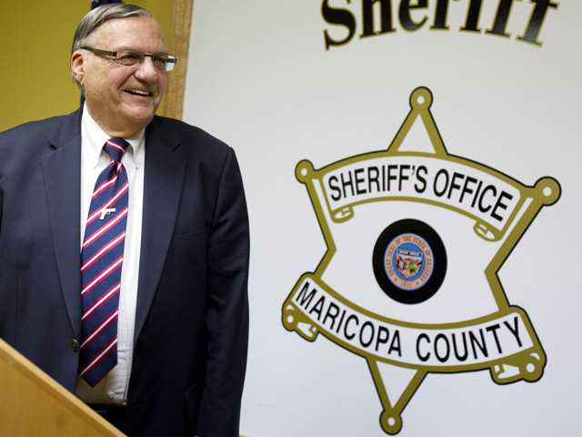 Maricopa County Sheriff Joe Arpaio talks with Media members Friday night  at his offices in downtown Phoenix.