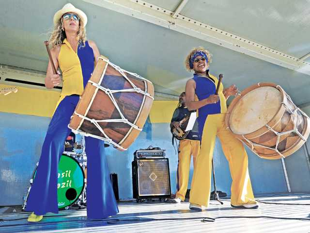 Ana Gazzola, left, and Sonia Santos of the band Brasil Brazil perform original compositions and traditional Brazilian music at a free concert presented by the Los Angeles County Arts Commission at West Creek Park in Saugus on Saturday evening.