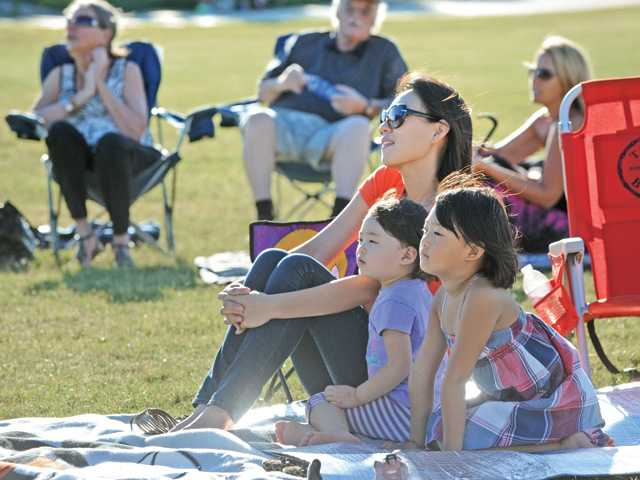 Cynthia Choi and daughters Erin, 2, and Sophia, 5, enjoy the original compositions and traditional Brazilian music performed the band Brasil Brazil at a free concert presented by the L.A. Arts Commission at West Creek Park in Saugus on Saturday evening.