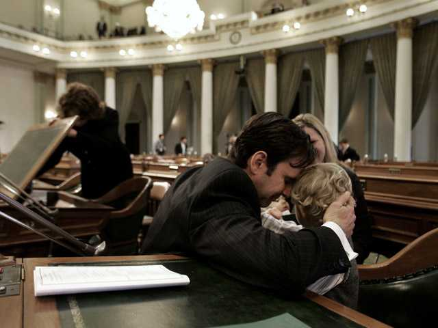 Assemblyman Cameron Smyth, left, hugs his son, Gavin, 3, while sitting in the Assembly before session at the Capitol in Sacramento on Dec. 4, 2006, when he was sworn into office for the first time.