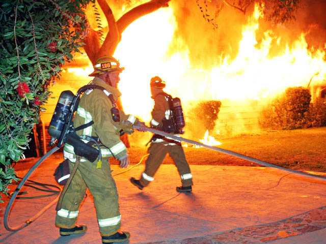 Firefighters battle a fully involved single-family home on the 24400 block of Arcadia Street in Newhall on Monday morning. Photo courtesy of Adam VanGerpen