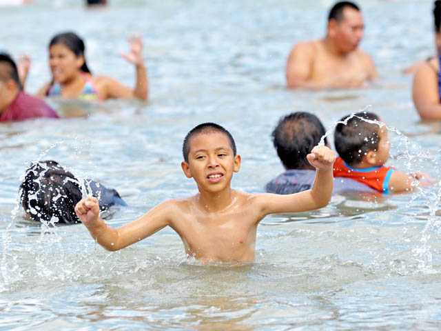Luis Bonilla, 9, plays in the water.