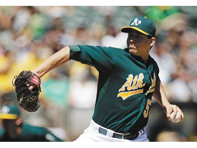 Oakland Athletics pitcher and Saugus High graduate Tommy Milone works against the Los Angeles Angels on Monday in Oakland.