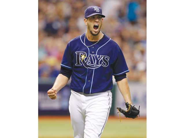 Tampa Bay Rays starting pitcher and Hart High graduate James Shields reacts during a 4-3 win over the New York Yankees on Monday in St. Petersburg, Fla.