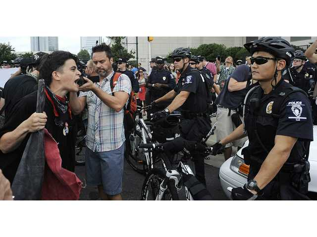 Occupy Demonstrators shout at police during an unscheduled protest march on Tuesday in Charlotte, N.C. The Democratic National Convention begins today.