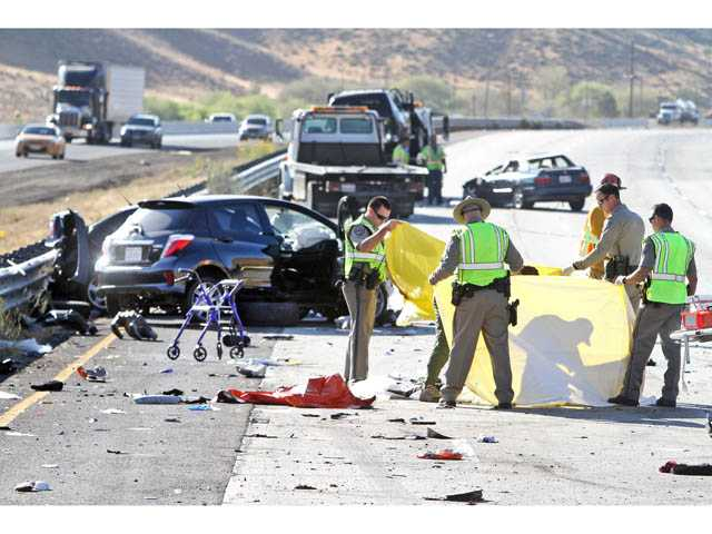 Emergency personnel respond to the scene of a multi-car pileup in the Grapevine stretch of southbound Interstate 5 in Gorman on Tuesday. Photo: Associated Press