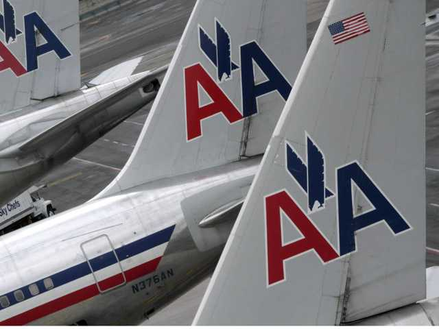 American Airlines airplanes are at parked at the gate at JFK International airport in New York. Bankruptcy Judge Sean H. Lane threw out the union contract of American Airlines' pilots as part of the company's restructuring Tuesday.