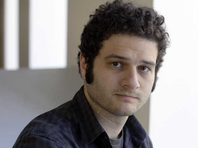 Dustin Moskovitz co-founder of the collaborative software company Asana, poses outside of his office in San Francisco.