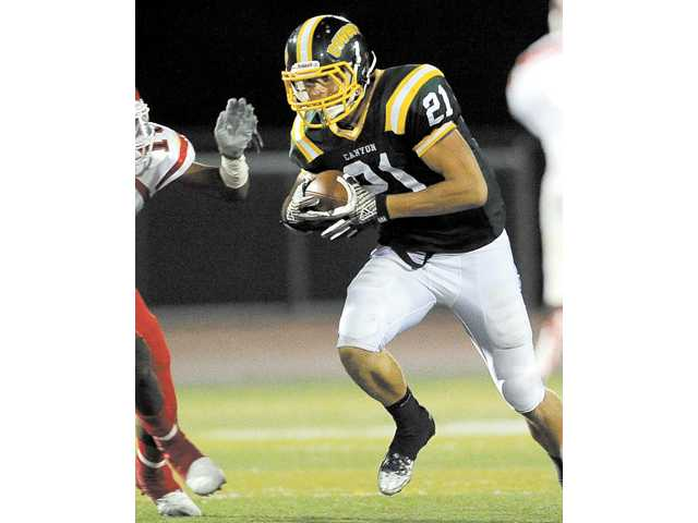 Canyon wide receiver Drew Wolitarsky runs against Morningside High on Aug. 23 at Canyon High.