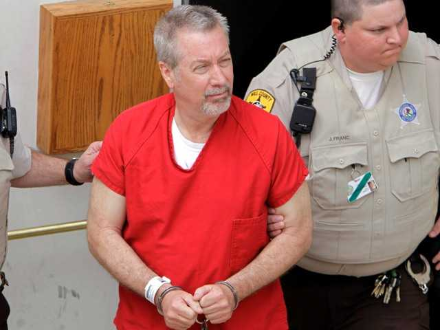 In this 2009 photo former Bolingbrook, Ill., police sergeant Drew Peterson leaves the Will County Courthouse in Joliet, Ill., after his arraignment on charges of first-degree murder.
