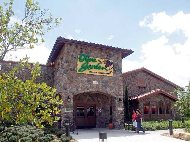 An Olive Garden restaurant is shown in Hialeah, Fla., Thursday. Servers at Olive Garden, Red Lobster and other eateries are suing the restaurants' parent company, claiming they were cheated out of overtime pay and more.
