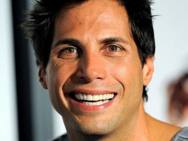 "In this 2010 photo Joe Francis arrives at a screening of the film in Los Angeles. Francis and Steve Wynn faced off before jurors Tuesday over charges the casino mogul threatened to kill the ""Girls Gone Wild"" founder."