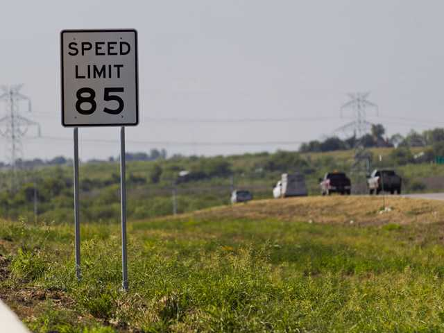 An 85 mph speed limit sign is placed on the 41-mile-long toll road in Austin, near the increasingly crowded Interstate between Austin and San Antonio, Texas.