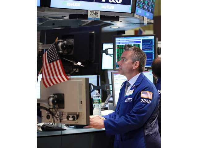 Specialist Christopher Culhane works the trading floor of the New York Stock Exchange.