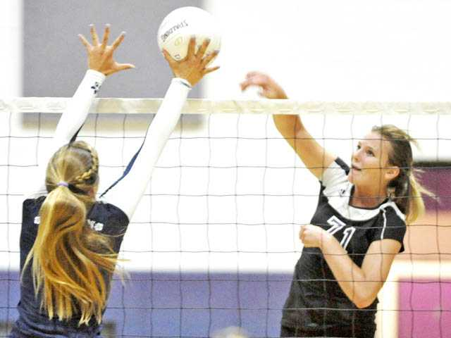 Valencia outside hitter Lindsey Knudsen (71) gets the ball past Dos Pueblos' Maddy Leiphardt on Thursday at Valencia High.