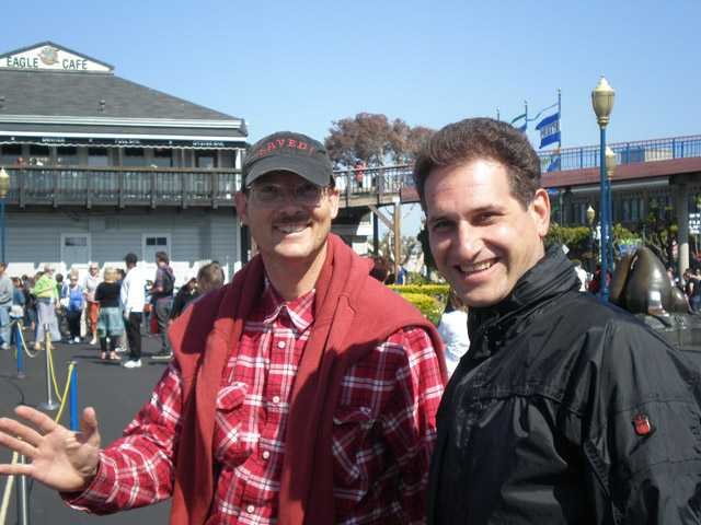 Michael Hansel, left, poses with a tourist at Pier 349 in San Francisco during one of his company's tours.