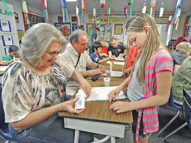 Linda Cantelosi, of Santa Clarita, and her granddaughter Heidi Cantelosi, a fourth grader, work on a project together during Grandparents Day at Plum Canyon Elementary School on Friday.