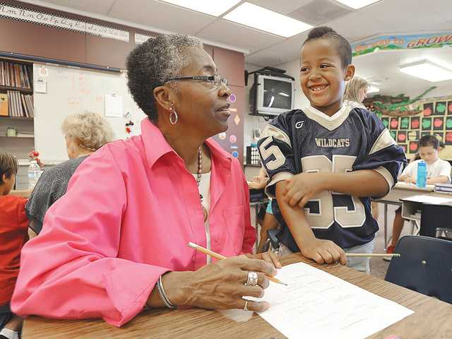 Pamela Sims, of Canyon Country and grandson Nate Benson, a third-grader, work on a project together during Grandparents Day at Plum Canyon Elementary School on Friday morning.