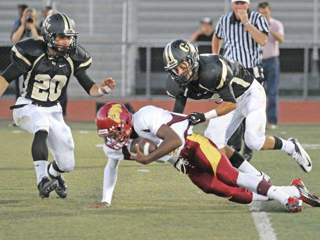 Prep football: Two through Golden Valley's fingers