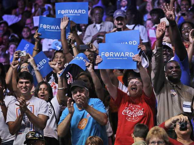 Supporters react as President Barack Obama speaks at a campaign event at Kissimmee Civic Center, on Saturday, in Kissimmee, Fla.