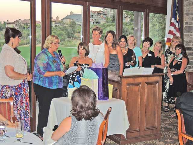 The 2012-13 slate of officers of Soroptimist International of SCV is installed at Tournament Players Club in Valencia.