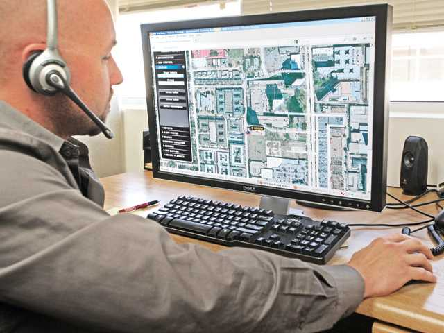 Salesman Nick Amelsberg uses the LiveView GPS tracking system in Valencia on Thursday.
