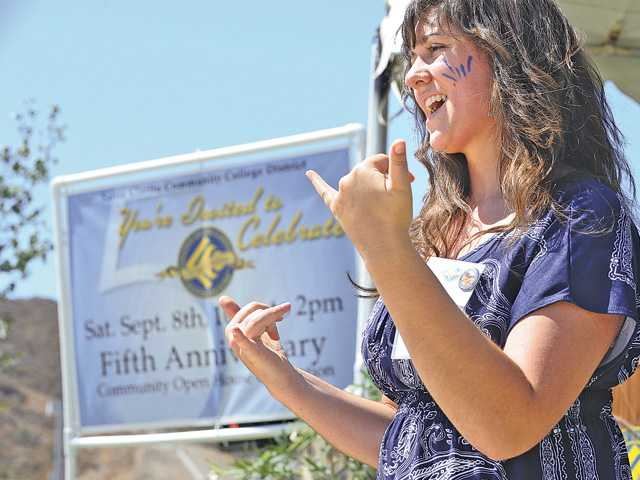 "College of the Canyons student Christina Hoffberg signs to the song ""Sparks Fly"" by Taylor Swift at the College of the Canyons Canyon Country campus on Saturday."