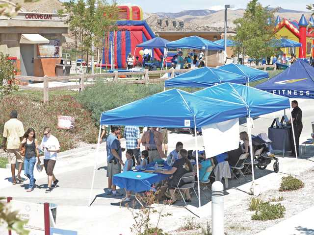 Attendees enjoy education booths and children's games at the College of the Canyons Canyon Country campus fifth year anniversary celebration in Canyon Country on Saturday.