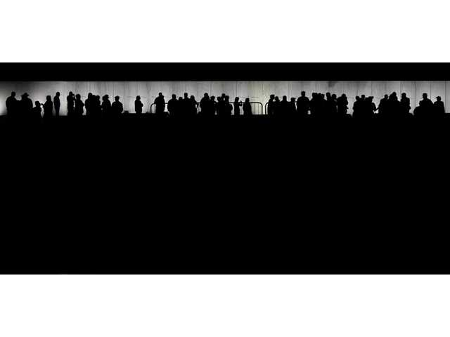 In this Sept. 10, 2011 photo, people gather at the Wall of Names during a vigil at Phase 1 of the permanent Flight 93 National Memorial.