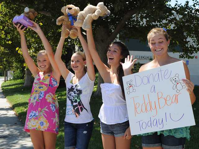 From left, Aubry Horney, Lane Judge,  Brittany Davidson and Haley Horney, students from Paraclete High School in Palmdale, volunteer at Henry Mayo Hospital's teddy bear drive.