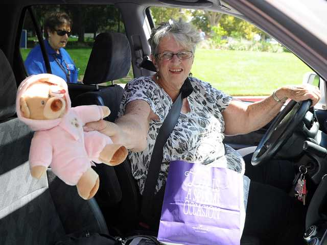 Pat Berkery donates a teddy bear in front of Henry Mayo Hospital for the teddy bear donation drive on Sunday.
