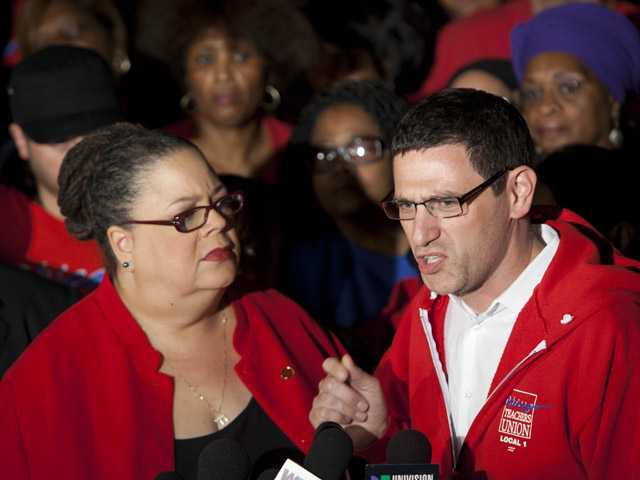 Chicago Teachers Union President Karen Lewis, left, listens to CTU Vice President Jesse Sharkey outside the union's headquarters on Sunday in Chicago.